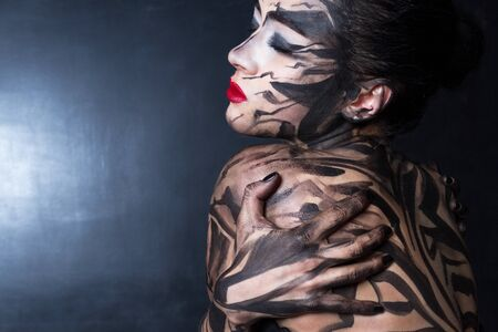 A painted woman. Stock Photo