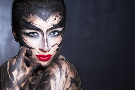 A painted woman with black paint.