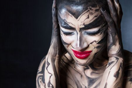 A painted woman with red lips.