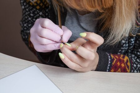Creation of a manicure with a pattern in the Easter style. Stock Photo
