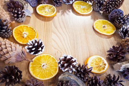 Christmas decor with orange slices and cones. Standard-Bild