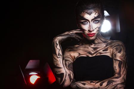Gorgeous woman in the spotlight. Standard-Bild