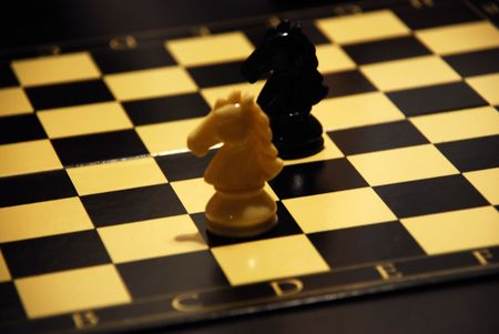 The chess board with two cavalier. Stock Photo