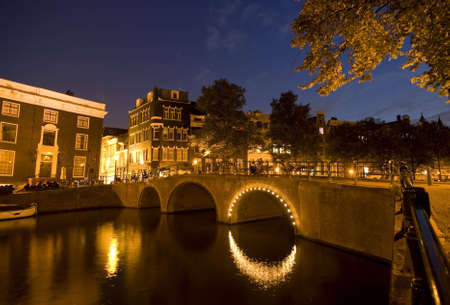 A wide angle shot of amsterdam at night Stock Photo