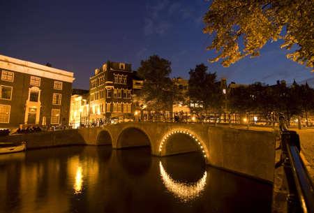A wide angle shot of amsterdam at night photo