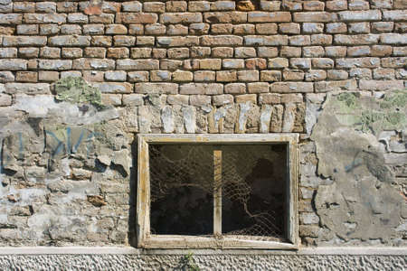 window and brick wall of an abandoned house in Pancevo, Serbia Stock Photo - 7918805