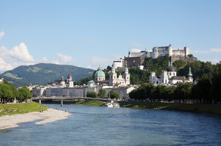 Castle Hohensalzburg and the city center along the river Salzach, Austria photo