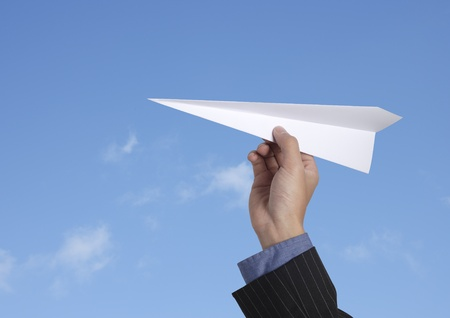 throw paper: business man throwing a paper plane  Stock Photo