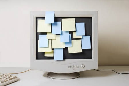 old computer monitor and paper notes  Stock Photo - 10602179