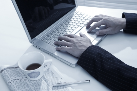 man hand typing on laptop computer in office  Stock Photo - 10602184