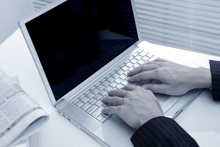 businessman man hand typing on laptop computer in office  Stock Photo - 10602181