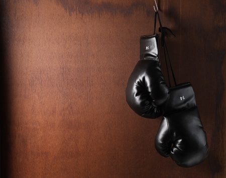 boxing gloves: boxing-glove hanging on grunge background  Stock Photo