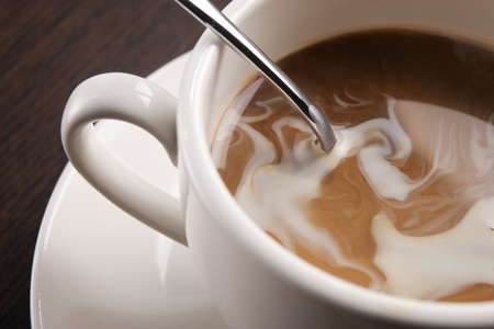 a cup coffee with cream swirl  Stock Photo - 10602151