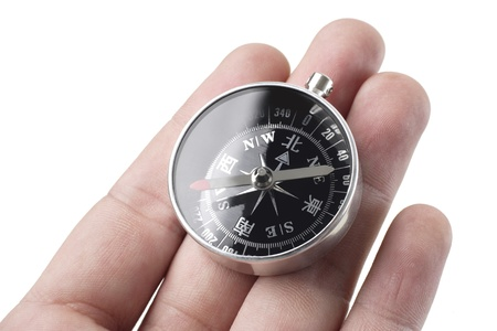 azimuth: hand holding the compass close up shoot  Stock Photo