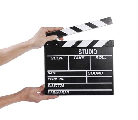 directors cut: hands holding out a clapper board
