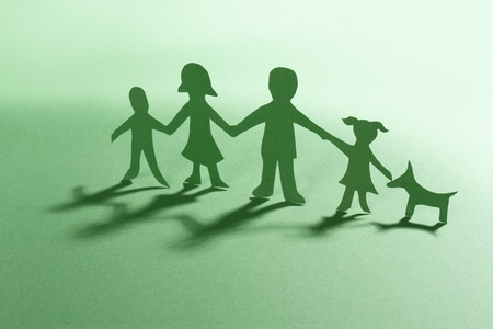 hand cut: green paper family with dog  Stock Photo