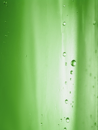 water drop on shower curtain.green color photo
