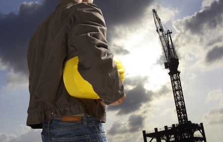 protective workwear: construction worker with building silhouette