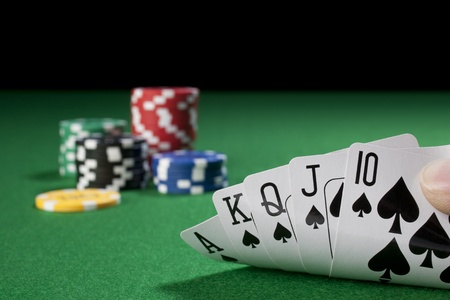 hand with royal flush,chips  photo
