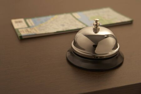 clang: hotel bell with map Stock Photo