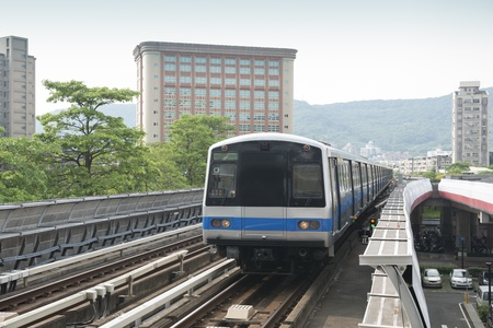 Elevated Commuter Train in motion photo