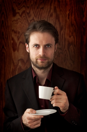 Forty years old business man drinking morning coffee Archivio Fotografico