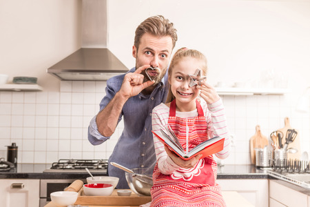 easter cookie: Caucasian father and daughter having fun while getting ready to bake cookies in the kitchen - happy family time.