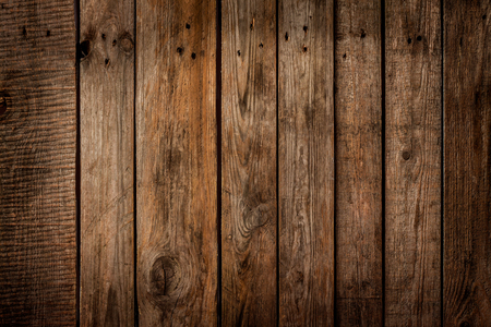 Old vintage planked wood board - rustic or rural background with free text space Imagens