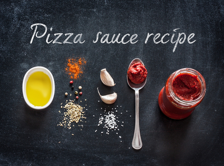 make a paste: Pizza topping sauce ingredients or recipe on black background.