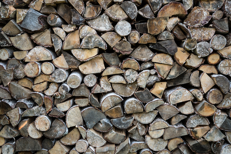 Stacked chopped birch firewood - background. Getting prepared for winter cold concept. 版權商用圖片