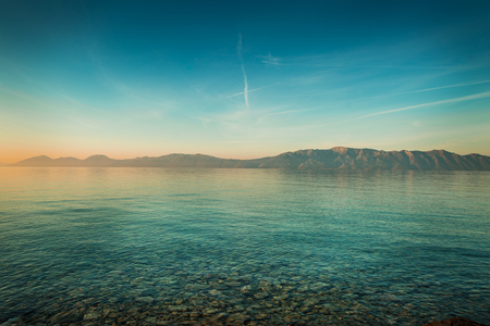 Peaceful landscape with sea and hills before sunrise. South Europe, Croatia - idyllic morning view from Hvar island.