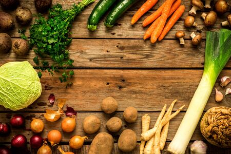 Autumn (fall) vegetables on vintage rustic wooden background. Rural kitchen table - flat lay composition (from above, top view). Layout with free text space.