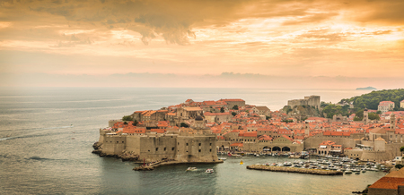 Panorama of Dubrovnik, historic city in Croatia, Europe. Wide view of old town. Summer sunset - warm colors landscape.