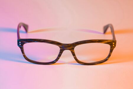 Glasses on colorful (multicolor tonal transitions) background - close up.  Stock Photo