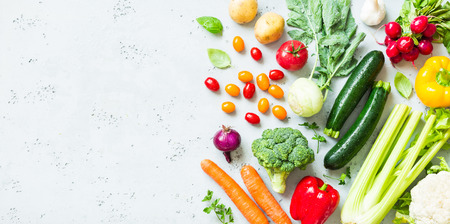 Kitchen - fresh colorful organic vegetables captured from above (top view, flat lay). Grey stone worktop as background. Layout with free text (copy) space. Archivio Fotografico