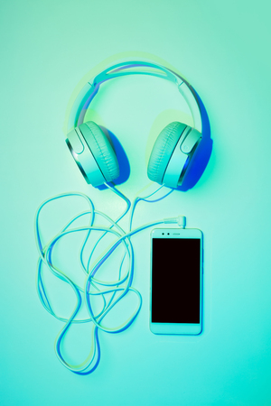 Mobile phone (smartphone) and headphones - poster layout design. Colorful (multicolor tonal transitions) background.