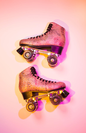 Retro pink glittery roller skates - poster layout design, disco style. Colorful (multicolor tonal transitions) background with free text (copy) space. Stock Photo