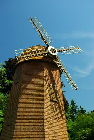 old working windmill creating energy on the farm