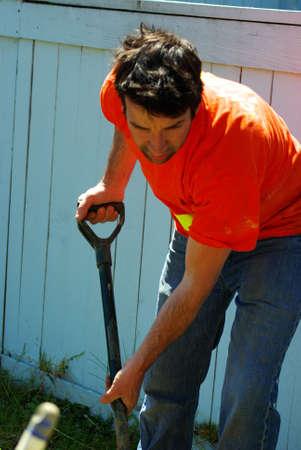 Gardener digging