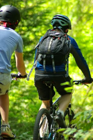 two bike riders speed by on trail Stock Photo - 1118018