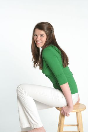 Sitting on a stool Stock Photo