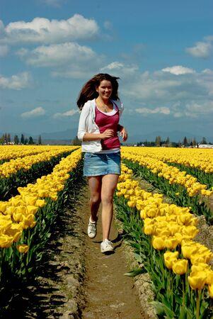 Running among the tulips Stock Photo - 4740115