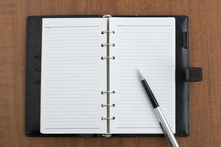 pocketbook: Pocketbook and pen Stock Photo