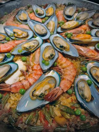 Malaga, Spain, June 2020 - Paella food mix of seefood and veggies