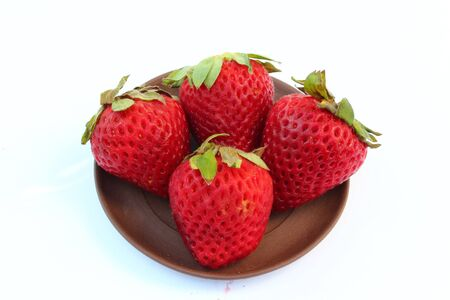 Strawberrys on Small brown palette Stock Photo - 16757177