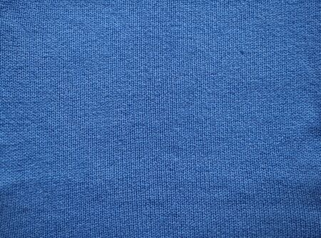 Knitted fabric texture. Blue. Garter stitch with facial loops. Knitting on the knitting needles. Archivio Fotografico
