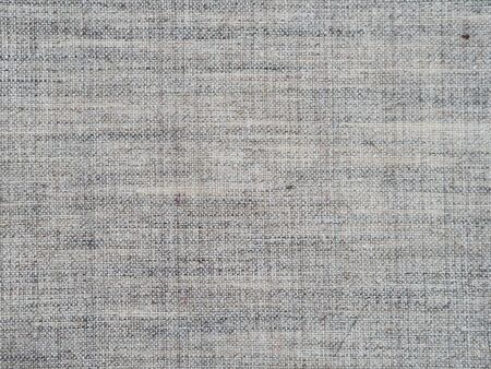 The texture of the canvas is a fabric made from natural cotton with the addition of viscose rayon. Fabric textile gray background.