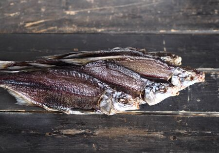 Air-dried,privately owned, freshwater river fish bream, on a dark wooden table. Close up.