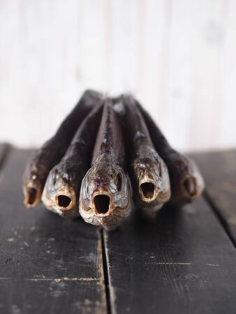 Air-dried,privately owned, freshwater river fish bream, on a dark wooden table.Close up.An intimidating sight, with an open mouth. Stock Photo