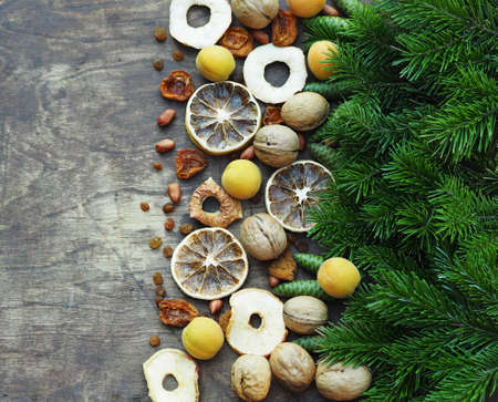 Happy New Happy full harvest year 2021. Branches of a Christmas tree are laid out on a wooden background. Christmas background.